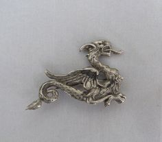 VTG SHUBE'S INC DAKOTA WEST STERLING SILVER GRIFFIN DRAGON WINGED CREATURE PIN