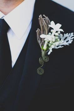 white + taupe boutonniere // photo by Mr. Haack // View more: http://ruffledblog.com/metallic-orange-county-wedding/