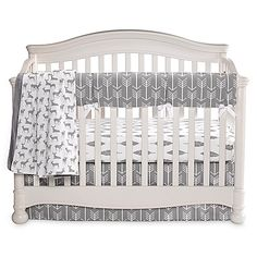 Create a modern yet rustic nursery with Liz and Roo's Woodland Crib Bedding Collection. In neutral gray and white, it features arrows, deer, feathers, and other woodland imagery in contemporary and stylish graphics.