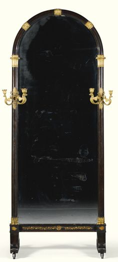 South German simulated rosewood and bronze mounted dressing mirror circa 1810, probably Munich of arched shape and with swan shaped two light gilt bronze appliques 188cm. high, 84cm. 50cm. deep; 6ft. 2in., 2ft. 9in. 1ft. 7 ¾in.