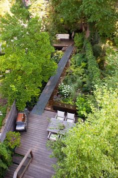 The garden's connective tissue is a boardwalk made of industrial steel grating, which floats above the hardy, shade-tolerant Lamiastrum planted below. The ground cover pokes its head through the grates from time to time / green home