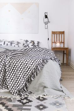 Black and white fringe-y spread. Chair as a night stand