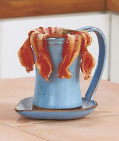 If you love bacon--and who doesn't?--you need this Ceramic Bacon Cooker in your kitchen. Our microwave cooker lets you avoid both standing at the stove and getting burned by the splattering grease while providing crispy, savory bacon for your table. Ceramic Cups, Glazed Ceramic, Ceramic Pottery, Microwave Bacon Cooker, Microwave Recipes, Ceramic Cooker, Coffee Cups And Saucers, Clay Projects, Handmade Pottery