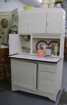 Vintage Hoosier Cabinet I foolishly left this exact cabinet at the first home Mike and I purchased. It was in the breeze way to the garage with our washer and dryer. It was an oversite as we loaded the moving truck. Didn't think about it for a year or so, then it was too late.