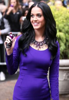 She is so gorgeous with black hair. I hate all the crazy colors. Never looks good on grown women.