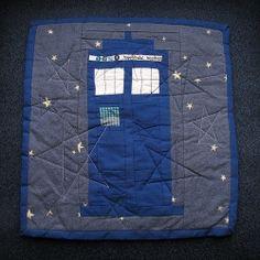 Yes, Doctor Who fans, that is a TARDIS mini quilt. Total geek craft. - Um, yeah I totally want to make this in adult people size!