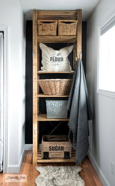 How to turn a new Ikea storage shelf into a rustic farmhouse beauty! The Henjne shelf was stained then stacked with vintage baskets and a crate stenciled with Pure Cane Sugar to house laundry, recycling and more! With Funky Junk's Old Sign Stencils. Ikea Storage Baskets, Bedroom Storage Shelves, Diy Storage, Storage Ideas, Bathroom Shelves, Laundry Baskets, Storage Solutions, Bathroom Ideas, Rustic Home Design