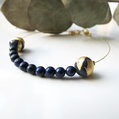 You can now order the Clementine Deluxe Lapis Lazuli Bracelet on #etsyshop and #etsywholesale ✨  The Clementine Deluxe Bracelet is composed with handmade polymer clay beads with gold leaf and beautiful gemstones. Here, the handmade pearls are navy blue and are perfect with the Lapis Lazuli stones  #EmmaS #handmadejewelry #madeinfrance #bridesmaidgift #lyon #wholesale