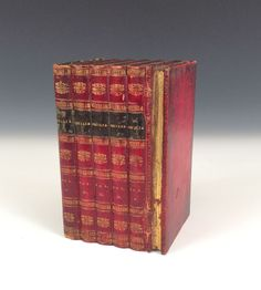 early English 19th century tea caddy in the form of a stack of red leather bound books