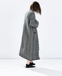 HERRINGBONE KNIT COAT from Zara.