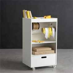 Pretty much perfect for Project Life Supplies-washi tape rolls below, paper products above and embellishment etc. in drawer. Wrapping Cart  | Crate and Barrel.