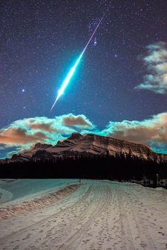 "earthyday: ""Fireball over Banff Rundle Mountain  by Brett Abernethy """