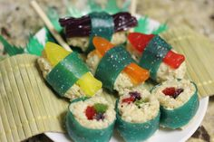 Candy Sushi  Ingredients:  - 1 tbsp butter  - 12 regular marshmallows  - 2 cups puffed rice cereal (Kellog's Rice Krispies or similar)  - Fruit Roll Ups  - Swedish Fish  - Colored Twizzlers  - Various other candy that you want to use as the roll filler or on top of the Nigri style sushi