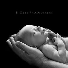 Newborn picture....love the baby in daddys hands