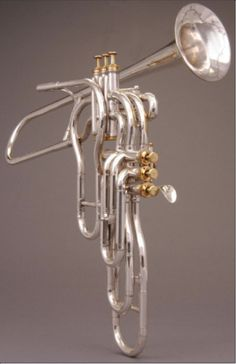 six valve trumpet. One advantage of the six valve trumpet seen on the right was better intonation. This particular instrument was designed by Adolphe Sax, the inventor of the saxophone. However, besides having a different and more challenging fingering system, the added weight of this horn was also an issue.