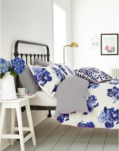 Joules Floral Butterfly Print Duvet Cover, Lake Blue Butterfly.                     Featuring an eye-catching butterfly print, this cotton duvet really brings a burst of spring to the bedroom. The reverse features a navy stripe that provides a stunning contrast.