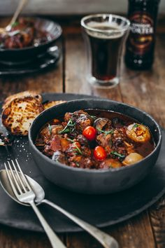Porter oxtail potjie with braaied spuds - Yuppiechef Magazine - Penny Palane - African Food Braai Recipes, Oxtail Recipes, Beef Steak Recipes, Jamaican Recipes, Cooking Recipes, Oven Recipes, Recipies, Cooking Rice, Cooking Games