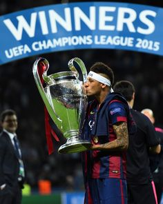 Neymar of Barcelona kisses the trophy after the UEFA Champions League Final between Juventus and FC Barcelona at Olympiastadion on June 6, 2015 in Berlin, Germany.