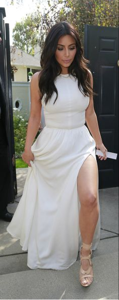 Kim Kardashian's white crop top, a maxi skirt which boasted a seductive slit, and her fave Tom Ford gladiator sandals.