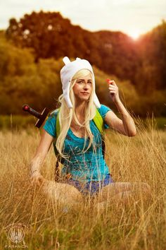 Finn the Human cosplay from Adventure Time by Stacey Rebecca. Photo by So Say We All.