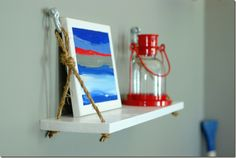 "This is the kind of shelf I want to hang above the boy's sink in their bathroom.  Looks ""ship-ish"" right???"
