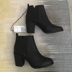 BNWT H&M booties Faux leather, three inch heel, stretch panel sides for easy on and off. These have been tried on in store one time. No damages. I simply lost the receipt and wasn't able to return them. Did not come with a box. H&M Shoes Ankle Boots & Booties