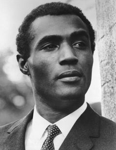 Calvin Lockhart was a Bahamian-American stage and film actor. He was best known for his role as Biggie Smalls, a big-time gangster in the 1975 Warner Bros. film Let's Do It Again alongside Sidney Poitier, Bill Cosby and Jimmie Walker . Black Actors, Black Celebrities, Celebs, Black Art Pictures, Vintage Pictures, Creation Photo, Vintage Black Glamour, Handsome Black Men, Black History Facts