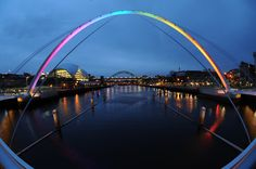 Gateshead Millennium Bridge, Gateshead Quays, Tyne & Wear, England, UK. A complex design was created to properly illuminate this tilting bridge. Two remote touchscreens allow bridge staff to manually control the lights.  Even at full intensity, the ColorReach Powercore fixtures consumes less than half as much energy as the previous fixtures.