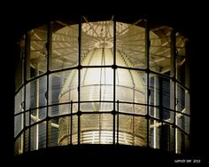 Look at this amazing photograph taken by Wendy Lee of Tybee Island lighthouse first order Fresnel lens at night. It beautifully illustrates the structure of what is often called a beehive optic. Here, you can see why.