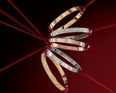 I want all of these Cartier love bangles... a girl can dream