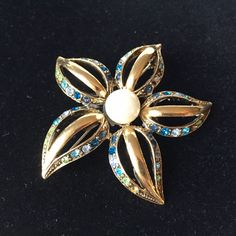 VINTAGE Gold Brooch Gorgeous Heavy Jeweled  Gold Flower with pearl center green and blue rhinestone accents by StudioVintage on Etsy