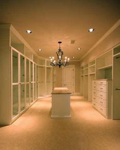 Holy crap. The king of all walk in closets. I would go completely Hollywood glam with the design. It would be my escape from everything else.