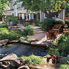 A sloping lawn became the inspiration for this backyard makeover that includes a pond, dining area with room for a grill; places for lounging and entertaining; a putting green; and an outdoor spa. Patio Pond, Ponds Backyard, Backyard Patio, Backyard Landscaping, Backyard Ideas, Garden Ponds, Garden Fountains, Backyard Waterfalls, Outdoor Fountains