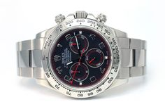 18k White Gold Rolex Cosmograph Daytona, Model 116509, Size 40 mm. Gorgeous black dial with red highlights and needle. #Rolex #Daytona #116509 #LuxuryWatch