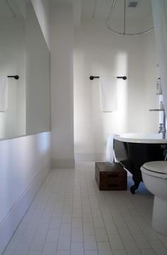 The clawfoot bathtub is painted with high-gloss enamel paint. Steal This Look: Ace Hotel Bathroom : Remodelista Restoration Hardware Medicine Cabinet, Recessed Medicine Cabinet, Ace Hotel Portland, Seattle Hotels, Hotel Bathroom Design, Hotel Bathrooms, Roman And Williams, Palm Springs Hotels, Claw Foot Bath