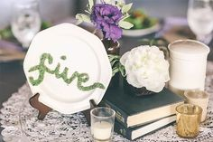 "Is This The Most Glorious Wedding Decor Ever - I love the table number done on the plate, spelled out and in what looks like ""moss""."