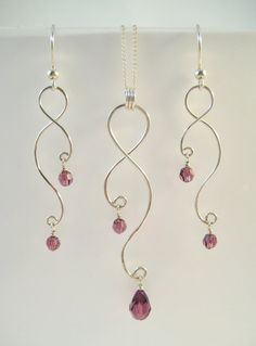 Curving Wire and Crystals - earrings and necklace