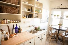 The bistro pub table in the kitchen is from Bellacor and the French-bistro style barstools are from World Market.