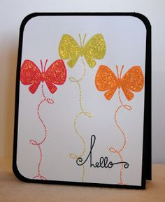 handmade card ,,, clean and simple ... three bright butterflies and their loopy flight pattern ... in GLITTER!!! ... fun way to say hello ...