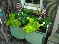 this is a antique wash tub turned into a flower box! I would plant prettier flowers. Pinks and purples