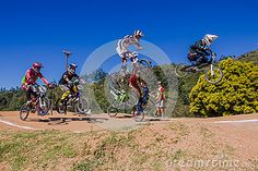 Photo about Male Teenagers Bmx bike riders air flying over the first ramp. Image of racing, action, gorge - 30803503 Bike Rider, Bmx Bikes, Teenagers, Action, Racing, Stock Photos, Boys, Sports, Travel