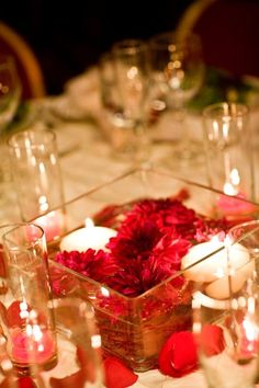 can use floating LED candle and deep burgundy dahlias or float roses like the hocus pocus roses
