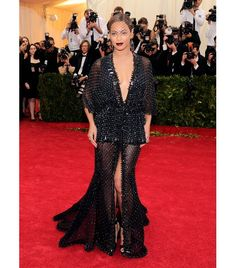 Beyonce Knowles Givenchy Haute Couture by Riccardo Tisci custom black dress in mousseline all over embroidered with crystals, stones, and studs, worn with matching bodysuit, embroidered fishnet tights and shiny crocodile leather all-over embroidered sandals; Philip Treacy mask; Lorraine Schwartz over 200 carats custom Black Diamond jewelry.