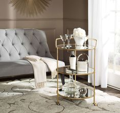 Designed for the hippest of hostesses, the diminutive Dulcinea bar cart is the solution to elegant service in small spaces. With mirrored glass shelves, chic steering handle and casters, this cart is crafted of sturdy iron with a lustrous silver finish. 4 H, Bar Cart Styling, Bar Cart Decor, Vintage Bar Carts, Gold Bar Cart, Bar Furniture, Online Furniture, Unique Furniture, Unisex