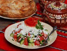 Shopska salad and banica(cheese -fetta and eggs strudel )behind Real Food Recipes, Cooking Recipes, Healthy Recipes, Shopska Salad, Bulgaria Food, Bulgarian Recipes, Food Wishes, Food Stamps, Food Challenge