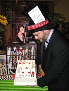 """""""The Mad Hatter"""", presenting the guest of honor with her """"5th"""" """"Un-Birthday"""" cake !"""