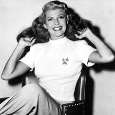 Rita Hayworth, 1940 The actress embraces androgynous style in a pair of wide-legged trousers and monochrome flats in 1940. Our new workwear ...