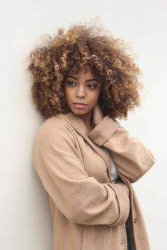 Inspiring curly afro chunky blonde highlights