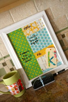 frame fabric, wallpaper, scrapbooking paper, etc., and the glass front  becomes a white board; easy to customize to match your decor, too