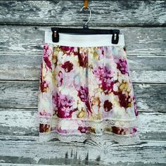 Lily White Skirt Floral skirt by Lily White. Size is large. Wide elastic waist band. Floral pattern is sheer and drapes down into two separate layers. White slip underneathe. Same pattern on front and back. Material is 100% polyester. Lily White Skirts Midi